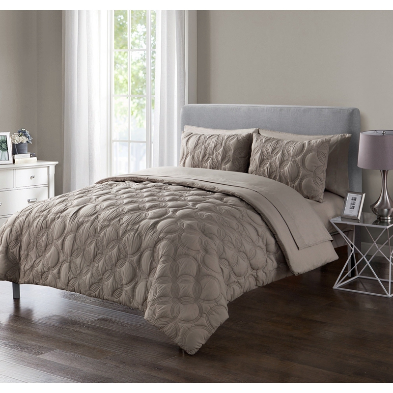 taupe embossed bed in a big 7 piece set