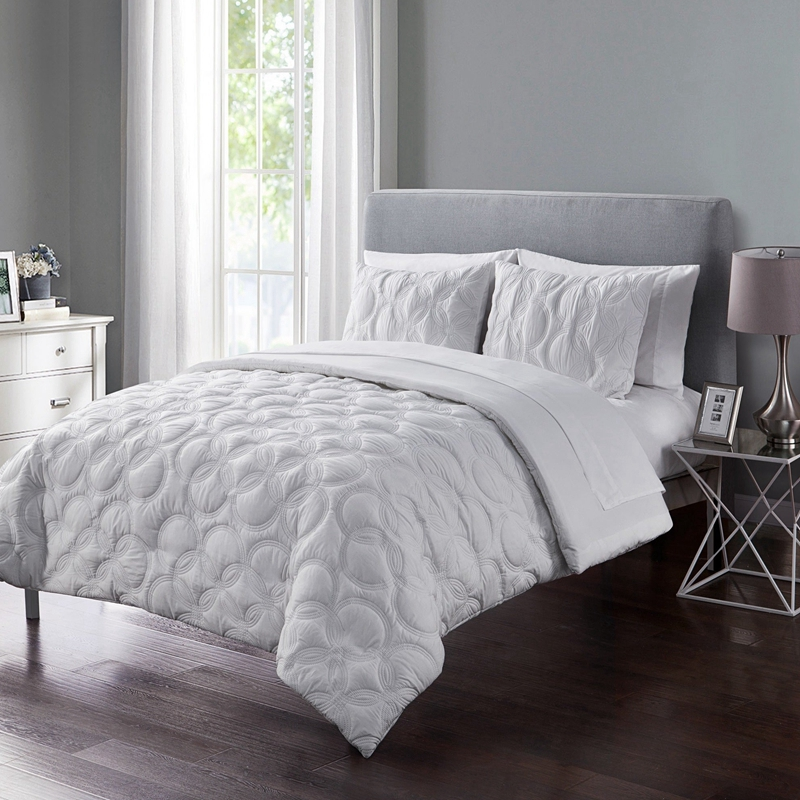 white embossed bed in a big 7 piece set